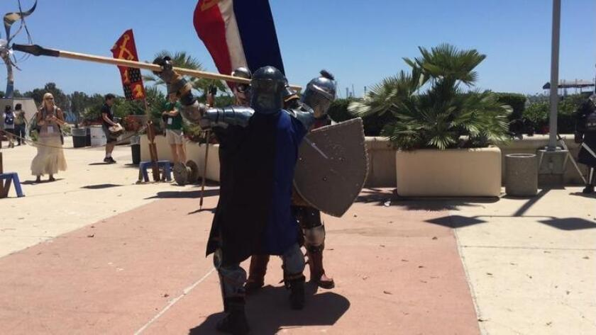 """Two members of The Adrian Empire fight outside of Comic-Con Friday. The stay of fighting is called """"rawlings fighting."""" (Abby Hamblin)"""