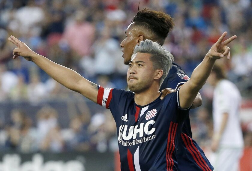 New England Revolution's Lee Nguyen, front, celebrates his goal on a penalty kick during the first half of an MLS soccer game against the New England Revolution, Saturday, May 28, 2016, in Foxborough, Mass. (AP Photo/Michael Dwyer)