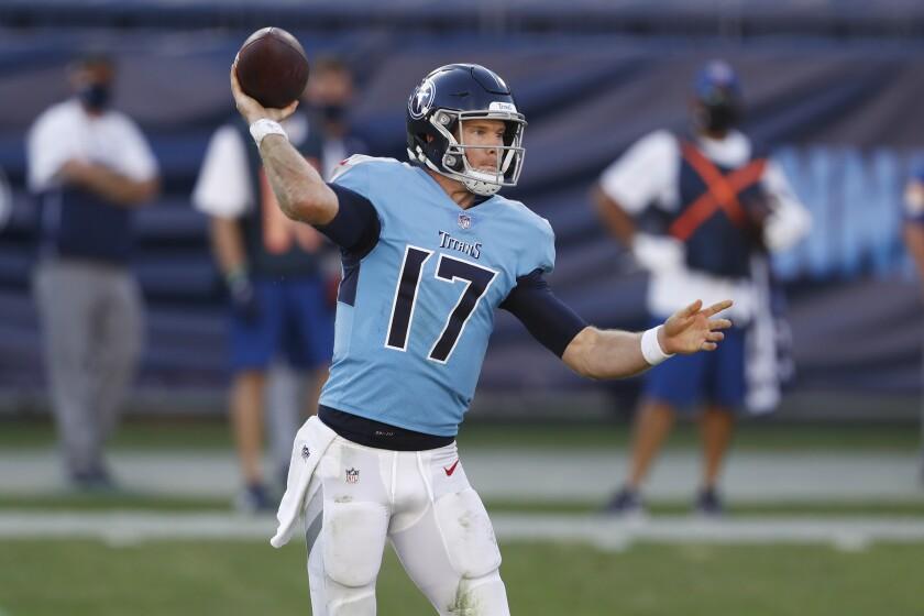 Titans quarterback Ryan Tannehill sets to unleash a pass.