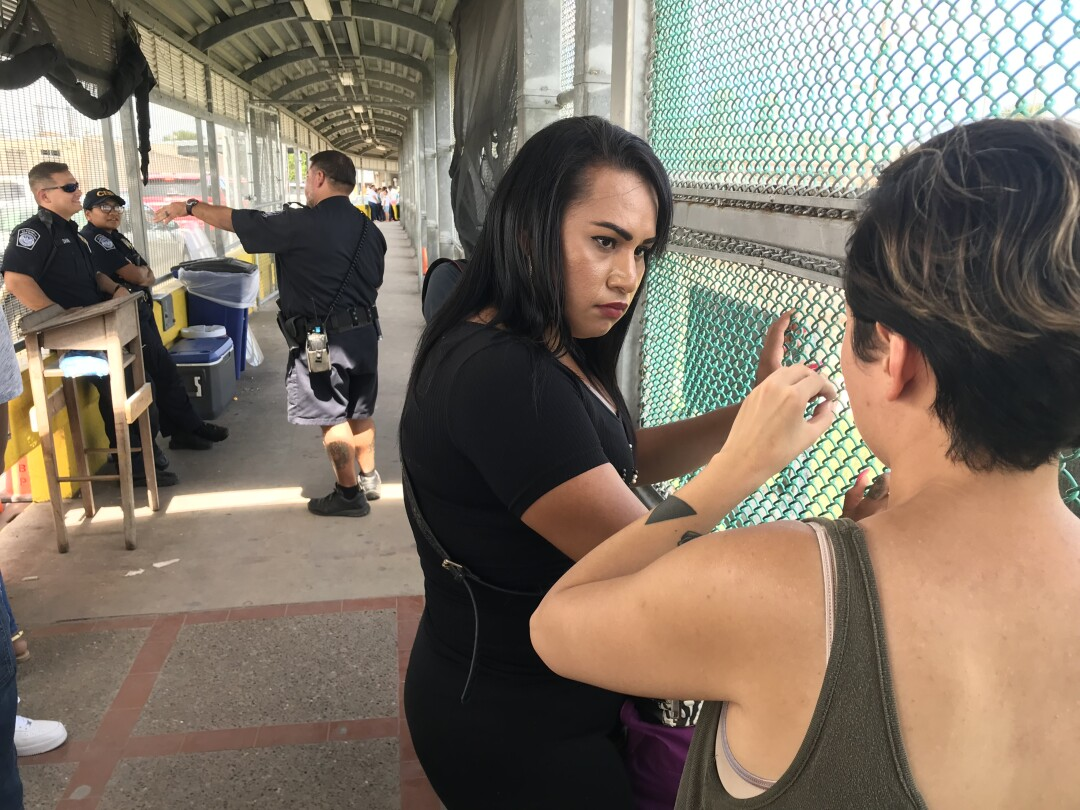 Salvadoran migrant Mayela Villegas consults with Dani Marrero Hi, a fellow at the Texas Civil Rights Project, at the border bridge from Matamoros, Mexico, to Brownsville, Texas.