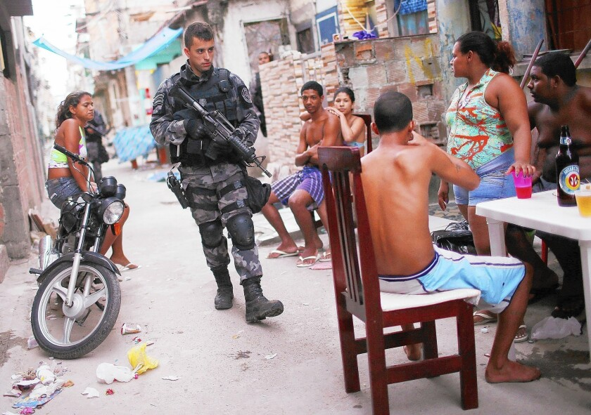 A Brazilian military police officer carries out a patrol in the Complexo da Mare slum in Rio de Janeiro. Seeking to improve public safety, police have established a permanent presence in many of the city's slums.