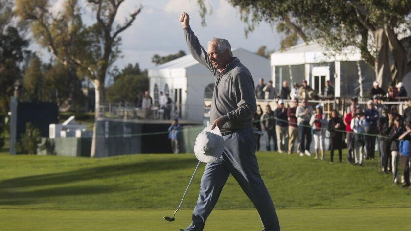 Kirk Triplett gestures to the crowd after defeating Woody Austin to win last year's Hoag Classic at Newport Beach Country Club.