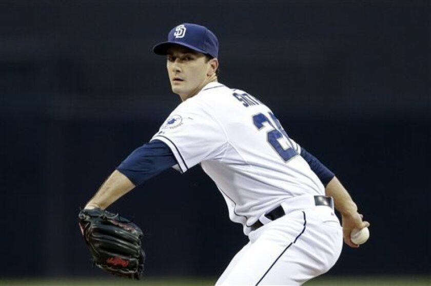 San Diego Padres starting pitcher Burch Smith throws against the St. Louis Cardinals during the first inning of their baseball game Wednesday, May 22, 2013, in San Diego. (AP Photo/Gregory Bull)