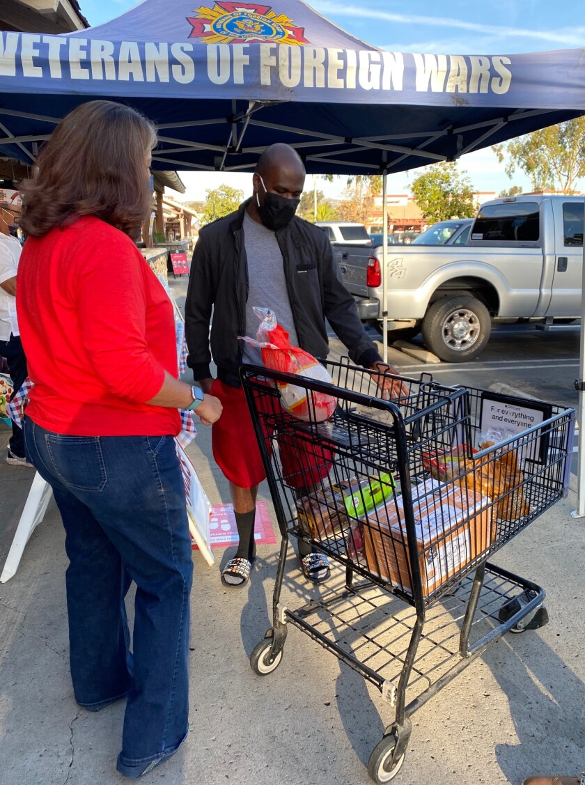 Maxonn Joseph, a Ramona resident who serves in the U.S. Navy, picked up his Turkey Bucks Thanksgiving meal Friday.