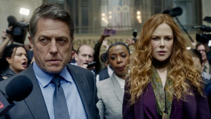 """En esta imagen difundida por HBO, Hugh Grant, Noma Dumezweni y Nicole Kidman en una escena de """"The Undoing""""."""