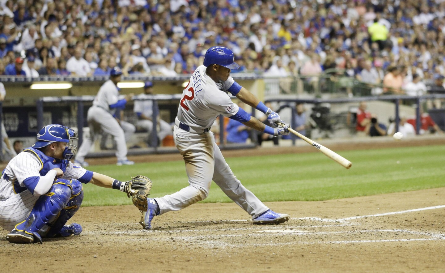 The Cubs' Addison Russell hits an RBI single during the sixth inning.
