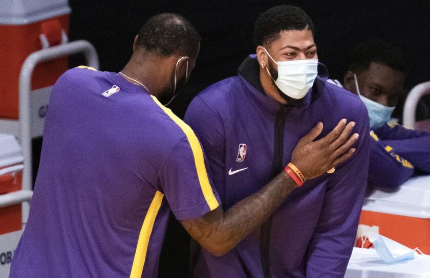 Lakers forward LeBron James, left, and forward Anthony Davis joke around during Friday's preseason game.