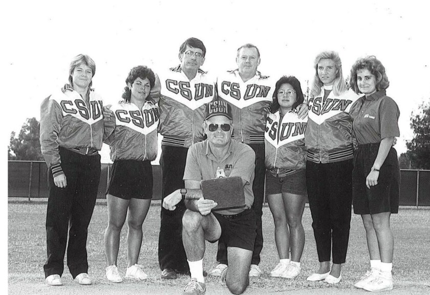 Hall of Fame Cal State Northridge softball coach Gary Torgeson, center, died March 21, 2020. He was 78.