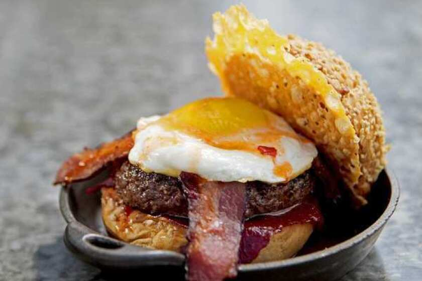 "The ""chef's favorite"" burger has cheese two ways, bacon two ways, ketchup leather, a sunny-side-up egg and hot sauce."