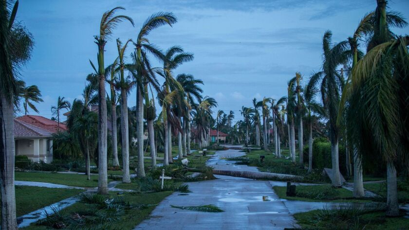 Debris litters the street following Hurricane Irma at Marco Island, Fla., on Sept. 11.