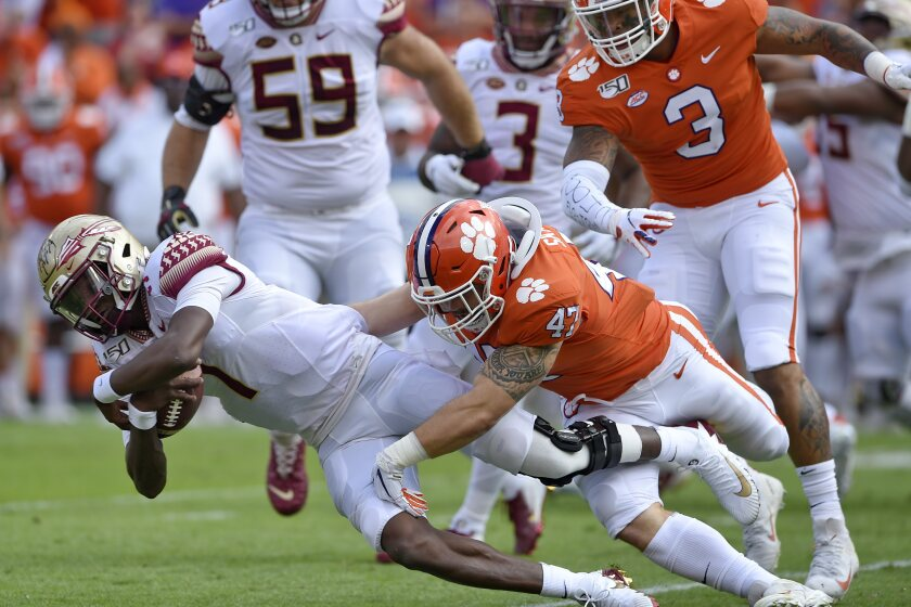 Florida State quarterback James Blackman is tackled by Clemson's James Skalski during the first half of an NCAA college football game Saturday, Oct. 12, 2019, in Clemson, S.C. (AP Photo/Richard Shiro)