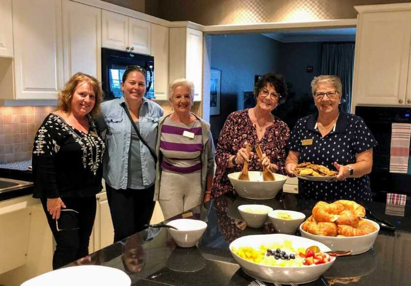 """Members of GFWC Contemporary Women of North County prepared a meal for families staying at the Fisher House at Camp Pendleton. A Fisher House is """"a home away from home"""" for military families of patients receiving medical care at major military and VA medical centers. Visit cwonc.org and fisherhouse.org."""