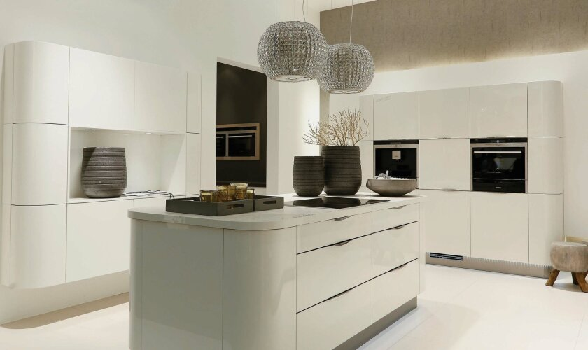 Glossy whites and gentle curves showed up everywhere at the kitchen trade show in Germany.