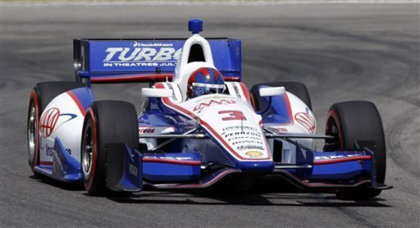 Helio Castroneves, of Brazil, heads into turn 17 during qualifying for the IndyCar Grand Prix of Alabama auto race on Saturday, April 6, 2013 in Birmingham, Ala. (AP Photo/Butch Dill)