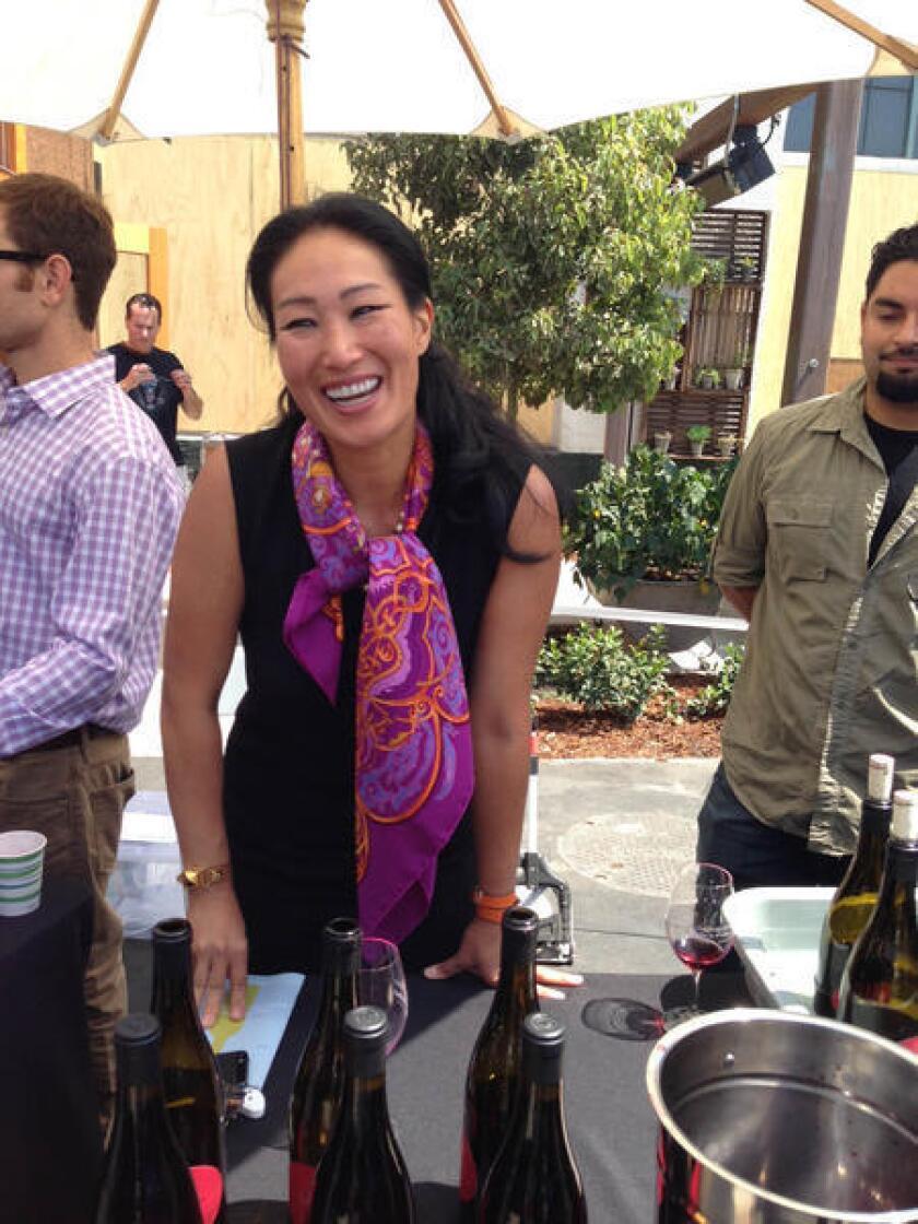 Jenni Bonaccorsi pours her wine at last year's Santa Barbara County Wine Futures Tasting.