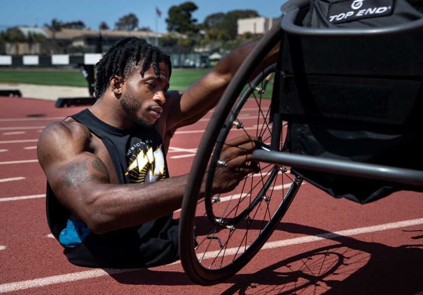 Zion Clark in San Diego preparing his chair for a training session for the Paralympic Trials in Minneapolis.