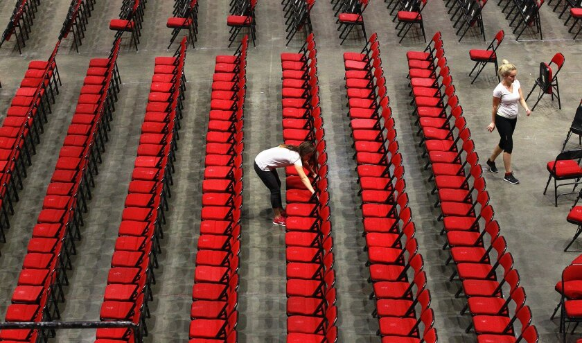 Gabriela Felix, left, and Alanna Phillips were among about a dozen San Diego State University students who set up chairs Wednesday at Viejas Arena for two graduation ceremonies Friday. The College of Health and Human Services ceremony is 10 a.m. and the College of Arts and Letters ceremony is 4 p.m