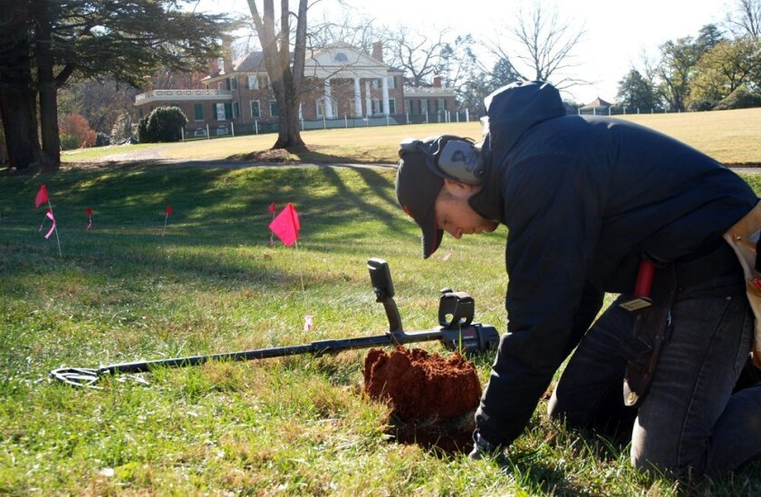 CORRECTS DATE OF PHOTO TO NOV. 14 NOT 15, AND LOCATION TO ORANGE, NOT MONPELIER, VA. - In this Thursday, Nov. 14, 2013, photo, Errol Belda, 26, of Bend, Ore.,  digs for an artifact after using  a metal detector to survey land in the shadow of James Madison's Montpelier, in Orange, Va. Archaeologist