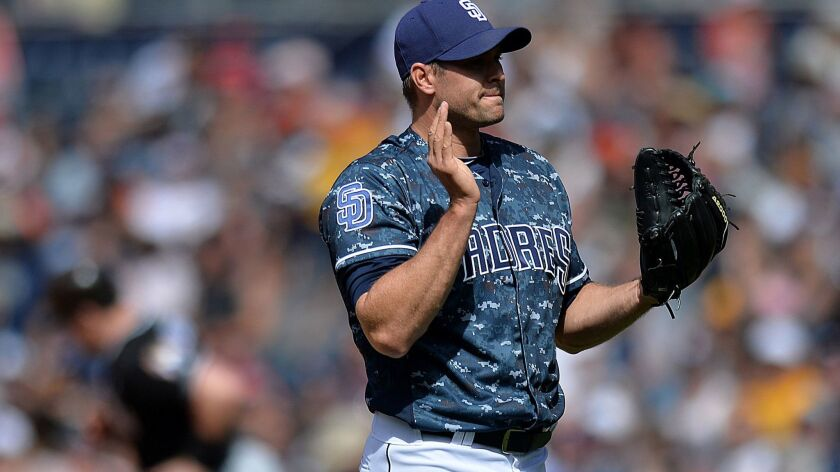 Padres relief pitcher Craig Stammen (34) reacts after giving up a three-run home run during the sixth inning to Miami Marlins first baseman Justin Bour (background) at Petco Park on April 23, 2017.