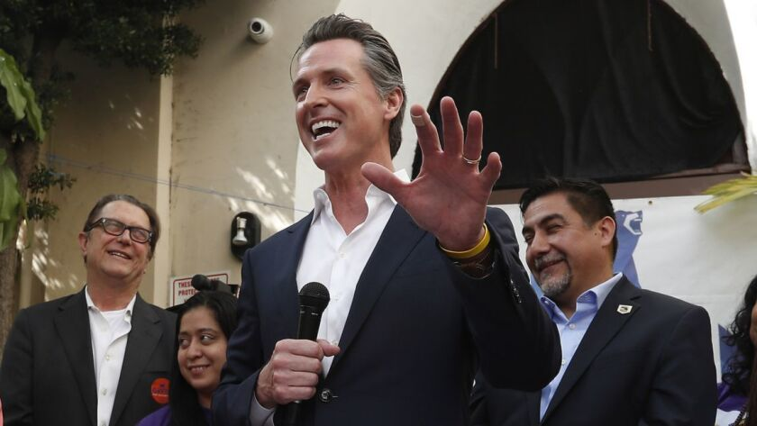 Lieutenant Governor Gavin Newsom speaks to a gathering at the El Gallo Cultural Plaza in East Los Angeles April 5.