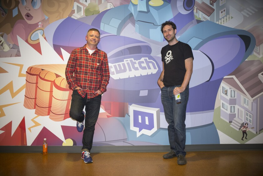 Jonathan Simpson-Bint and Emmet Shear, right, executives at Twitch, pose at the firm's offices in San Francisco on May 20, 2014.