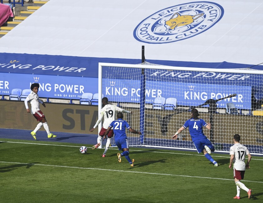 Arsenal's Nicolas Pepe, second left, scores his side's third goal during the English Premier League soccer match between Leicester City and Arsenal at the King Power Stadium in Leicester, England, Sunday, Feb. 28, 2021. (Michael Regan/Pool via AP)