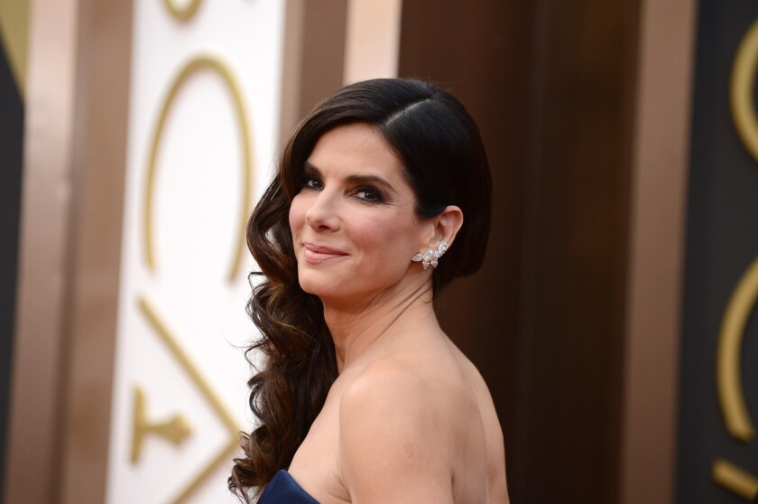 """People magazine has named Sandra Bullock the """"World's Most Beautiful Woman"""" for 2015. She is pictured at the 2014 Academy Awards ceremony."""