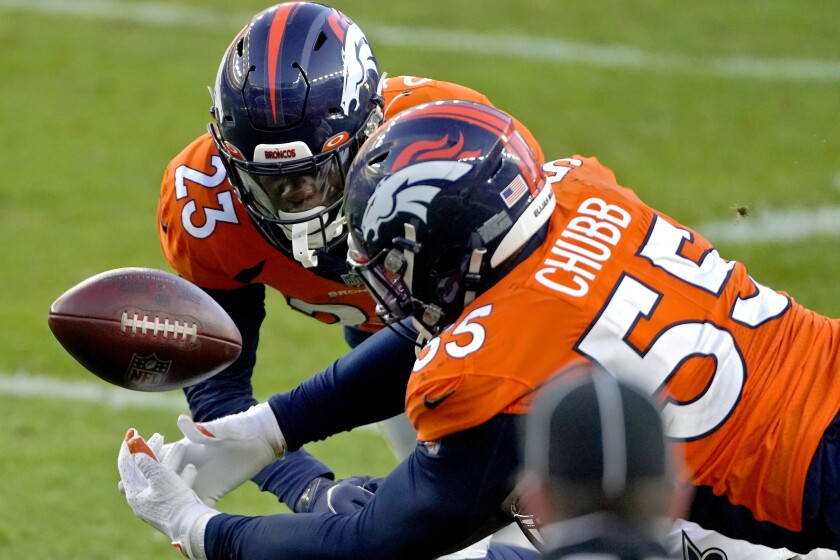 Denver Broncos outside linebacker Bradley Chubb (55) and cornerback Michael Ojemudia (23) can't hold on to an incomplete pass against the New Orleans Saints during the second half of an NFL football game, Sunday, Nov. 29, 2020, in Denver. (AP Photo/Jack Dempsey)