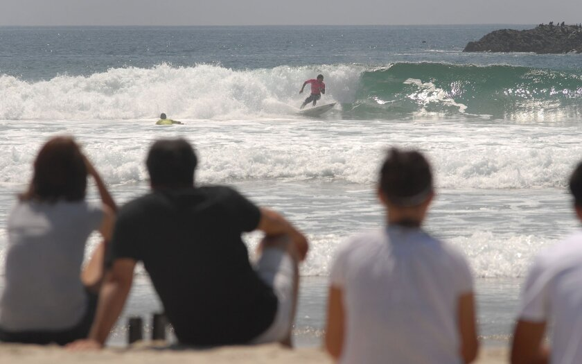 Spectators watch competitors during the first Rosarito Beach Pro AM Surf Competition last year. A new public relations campaign aims to bring more tourists to Rosarito Beach and the other four municipalities in Baja California.