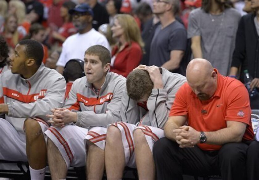The Ohio State bench watches as their team loses 70-66 to Wichita State in the West Regional final in the NCAA men's college basketball tournament, Saturday, March 30, 2013, in Los Angeles. (AP Photo/Mark J. Terrill)