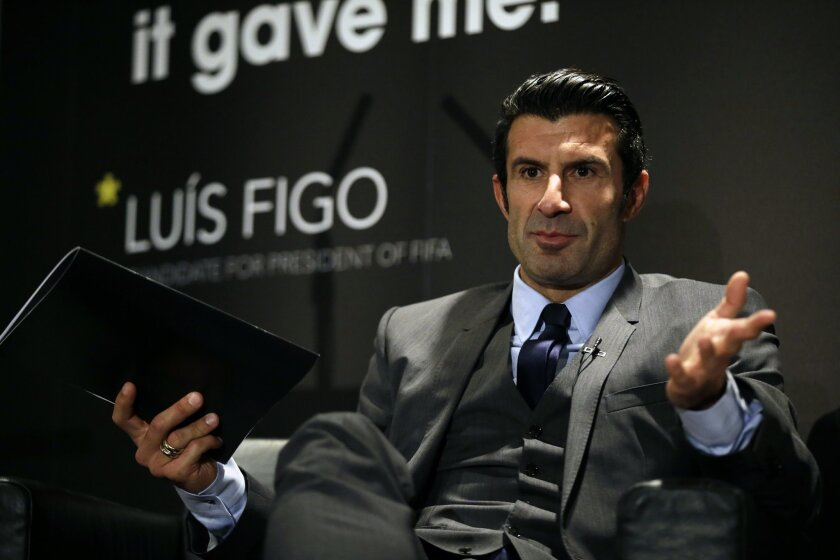 FILE - In this Thursday, Feb. 19, 2015 file photo, Luis Figo speaks to the media as he launches his FIFA Presidential Campaign manifesto, at Wembley Stadium, London. Sepp Blatter's widely expected re-election on May 29 as president of soccer's world governing body for a fifth term has seldom seemed a real contest. Three rival candidates entered the race in January: Prince Ali bin al-Hussein of Jordan, Luis Figo of Portugal and Michael van Praag of the Netherlands. Van Praag, however, dropped out of the race on Thursday May 21, 2015, and switched his support to FIFA vice president Prince Ali. (AP Photo/Matt Dunham, File)