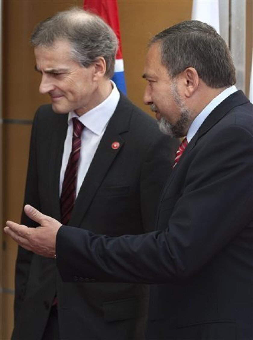 Norwegian Foreign Minister Jonas Gahr Stoere, left, and Israeli Foreign Minister Avigdor Lieberman, meet at the Foreign Ministry in Jerusalem, Wednesday, March 2, 2011. Stoere is on an official with to Israel and Palestinian territories. (AP Photo/Sebastian Scheiner)