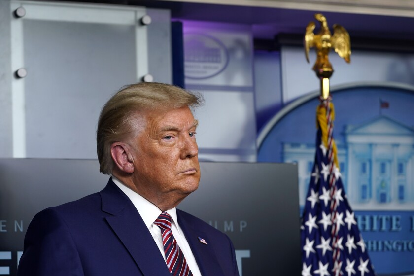 President Trump listens during a news conference at the White House on Nov. 20.