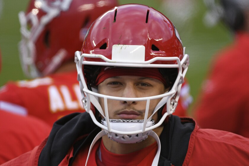 Kansas City Chiefs quarterback Patrick Mahomes walks on the sideline during the second half of an NFL divisional round football game against the Cleveland Browns, Sunday, Jan. 17, 2021, in Kansas City. (AP Photo/Reed Hoffmann)