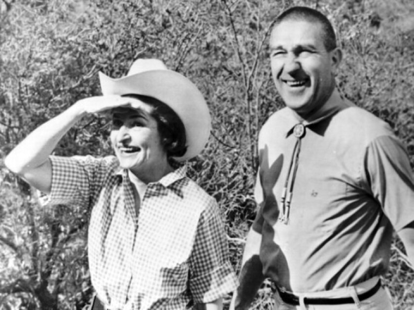 Stewart Udall, who served as Interior secretary under presidents Kennedy and Johnson, hikes with Lady Bird Johnson in 1966.