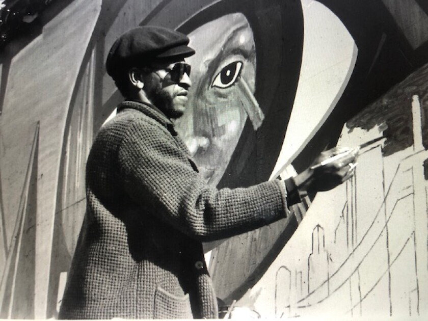 Roderick Sykes painting a mural
