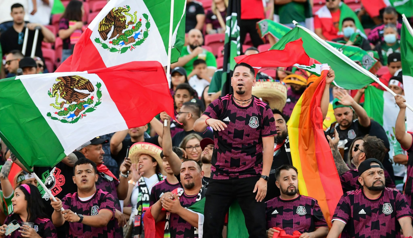 Mexico fans wave flags before an international friendly between Mexico and Nigeria at the Coliseum on Saturday.