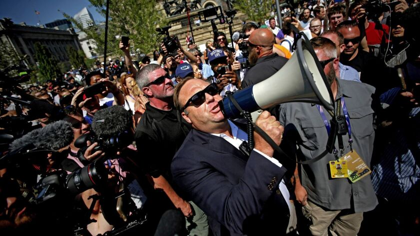 Radio host and conspiracy theorist Alex Jones speaks to crowds outside the Republican National Convention in Cleveland in 2016.