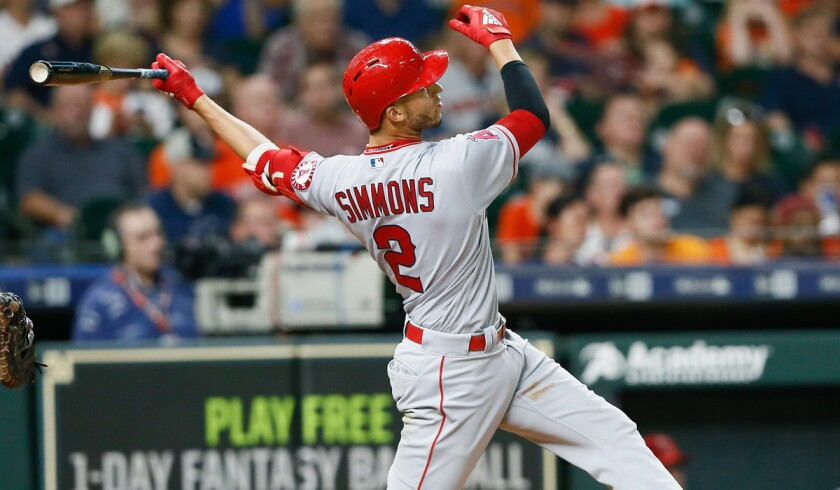 Angels shortstop Andrelton Simmons, hitting a home run against Houston in August, is a recipient of a Gold Glove for the fourth time.