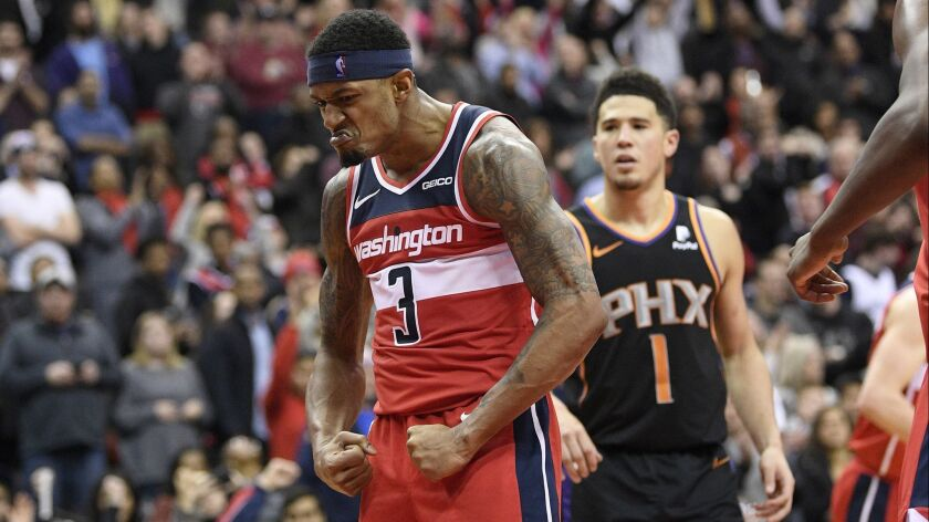 Washington Wizards guard Bradley Beal (3) reacts after he made a basket during triple overtime of a