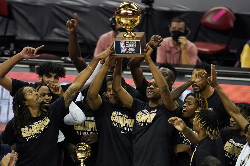 Sacramento Kings players hold up the trophy after defeating the Boston Celtics in the NBA summer league championship basketball game Tuesday, Aug. 17, 2021, in Las Vegas. (AP Photo/John Locher)