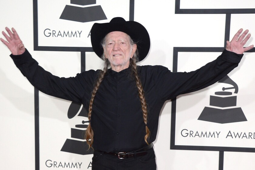 Willie Nelson arrives at the 56th annual Grammy Awards at Staples Center in L.A. on Sunday. He, Merle Haggard and Kris Kristofferson will perform together during the show.