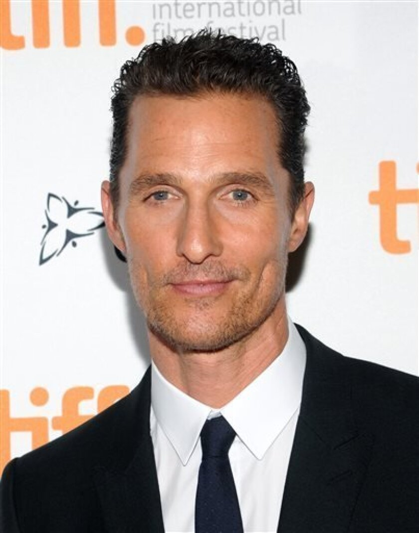 """Actor Matthew McConaughey arrives at the premiere of """"Dallas Buyers Club"""" on day 3 of the 2013 Toronto International Film Festival at The Princess of Wales Theatre on Saturday, Sept. 7, 2013 in Toronto. (Photo by Evan Agostini/Invision/AP)"""
