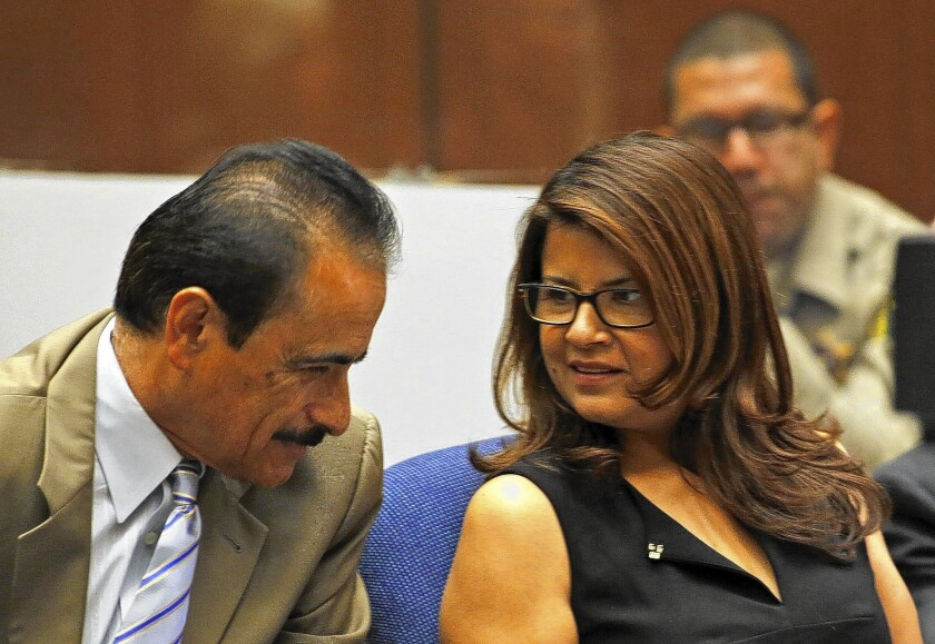 Former L.A. Councilman Richard Alarcon and his wife, Flora Montes de Oca Alarcon, speak in court on July 8. Alarcon and his wife are accused of lying about their place of residence so that he could qualify for office.