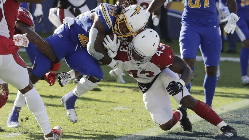 Chargers running back Melvin Gordon runs into the end zone for a touchdown as Cardinals outside linebacker Haason Reddick attempts a tackle.