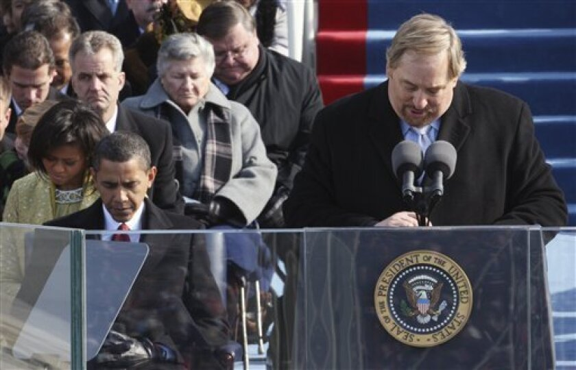 The Rev. Rick Warren, of the Saddleback Church in Lake Forest, Calif., gives the invocation as President-elect Barack Obama and his wife, Michelle, left, bow their heads during swearing-in ceremonies at the U.S. Capitol in Washington, Tuesday, Jan. 20, 2009.  (AP Photo/Ron Edmonds)