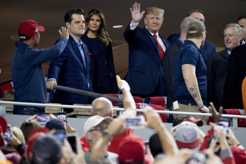 Rep. Matt Gaetz, R-Fla., second from left, joins Donald Trump and Melania Trump  for Game 5.