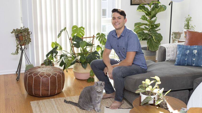 LOS ANGELES — July 3, 2018: Anthony Gulino, 33, in his Los Feliz apartment with his plants and cat