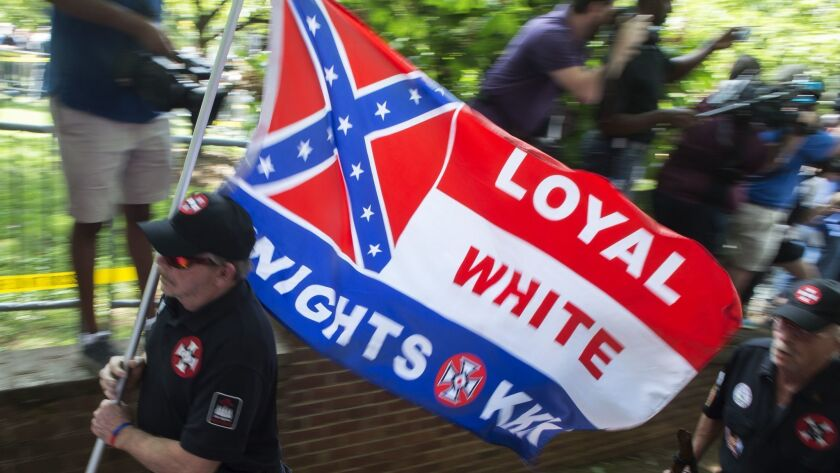 Hate groups like the Ku Klux Klan, shown at their July 8, 2017, rally in Charlottesville, Va., will be able to meet in public libraries.