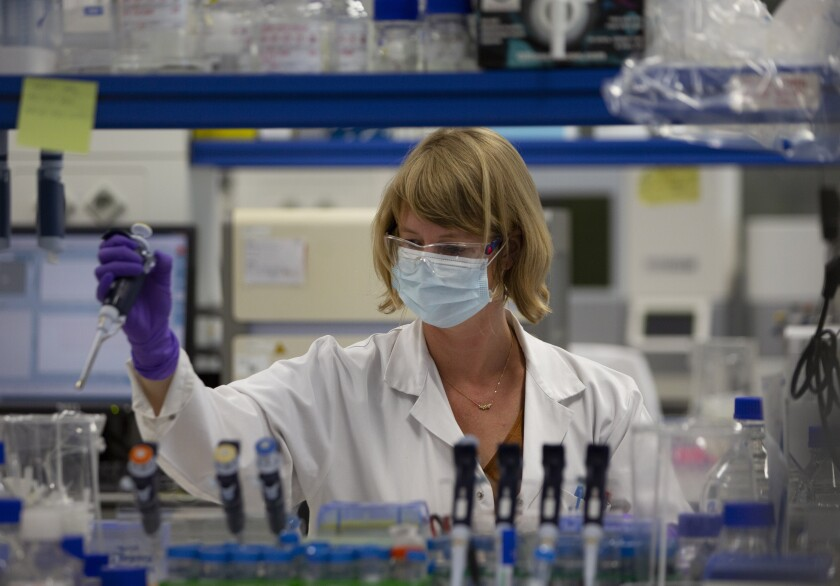 A lab technician conducts COVID-19 research at Johnson & Johnson subsidiary Janssen Pharmaceuticals in Beerse, Belgium.